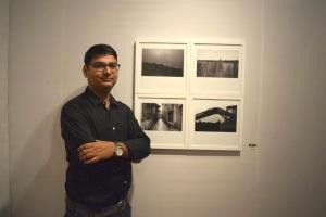 Artist Mrityunjay Kumar with his photography works